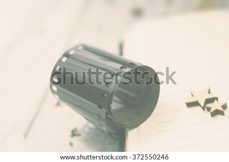 Photographic film on the white wooden background. Hipster soft and pastels colors - stock photo