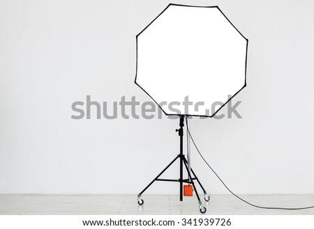 Photographic lighting in an empty studio - stock photo
