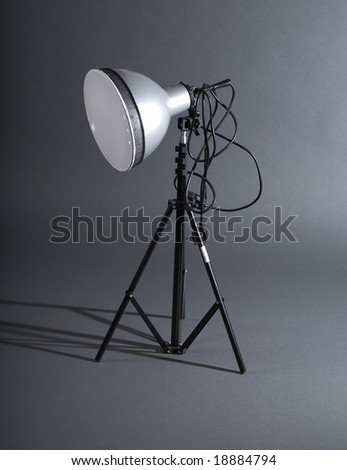 Photographic reflector on a grey background - stock photo