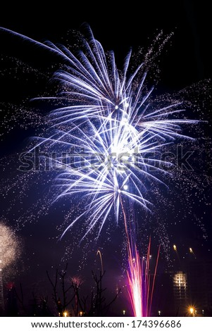 Photographing of salutes and fireworks in the night sky celebrate data The sky Night abstraction Holiday natural phenomena Pyrotechnics celebrites Salute Fireworks Christmas heaven-high power colors  - stock photo