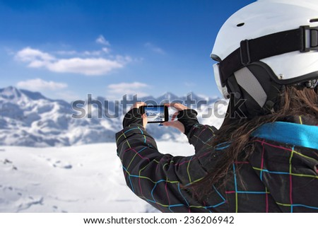 Photographing winter landscape mountains and snow, with cell phone