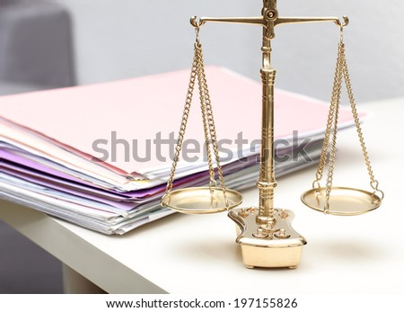 photography close up of scales of justice - stock photo
