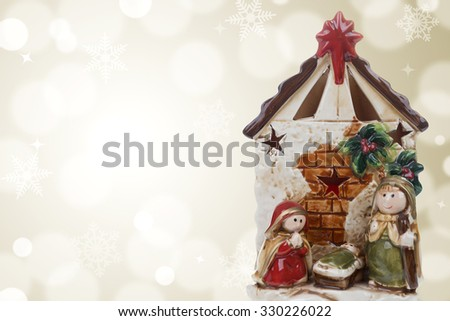 Photography of a Christmas nativity scene with the Virgin Mary, St. Joseph and baby Jesus on a golden bokeh background. Stock photography. - stock photo