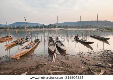 Photography of fishing boats on the mekong river with dawn at Khong Chiam, Ubon Ratchathani,Thailand - stock photo