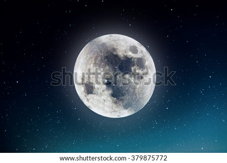 Photography of nightly sky with large moon and stars - stock photo