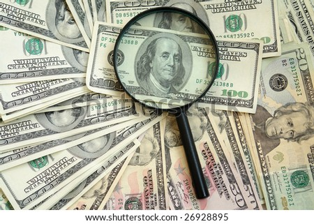 photography of the dollars with magnifying glass