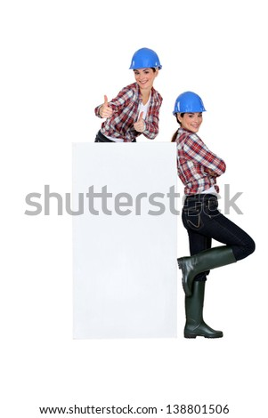 photomontage of girl with blue hard hat - stock photo