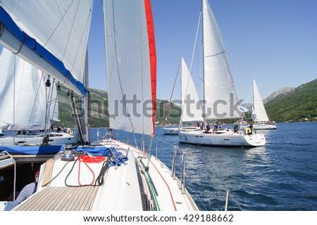 "Photos from the yacht. Tivat, Montenegro - 26 April, 2016. Regatta ""Russian stream"" in God-Katorskaya bay of the Adriatic Sea off the coast of Montenegro. - stock photo"