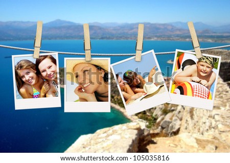 photos of holiday people hanging on clothesline with greek background - stock photo