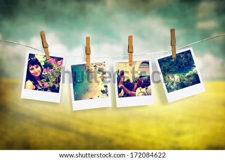 photos of holiday people hanging on clothesline with grunge background - stock photo