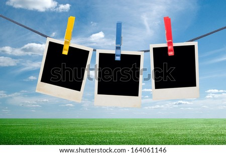 photos on a rope against sky background - stock photo
