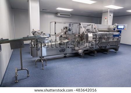 photos sterile production area with stainless steel machine for the production and sorting of pills and medicines