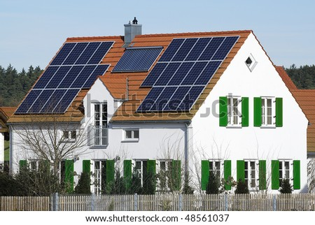 Photovoltaic and solar heating system at a house. - stock photo