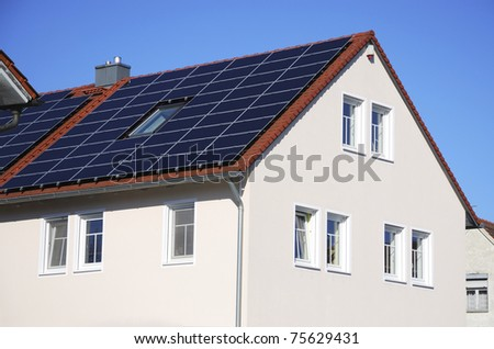 Photovoltaic cells on the roof of a house - stock photo