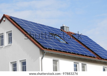 Photovoltaic installation on a residential house - stock photo