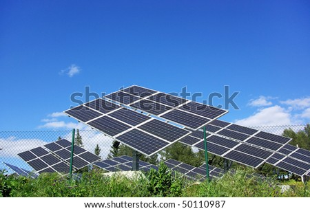 Photovoltaic panels in solar park. - stock photo