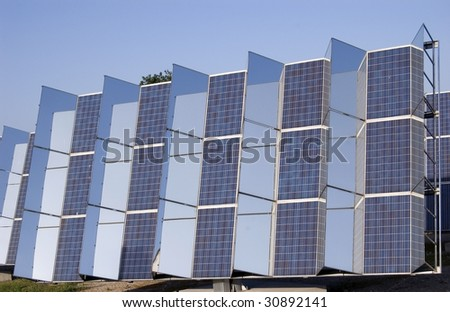 Photovoltaic panels with motorized mirror - stock photo