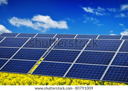 Photovoltaic renewable energy, green power, solar panel in nature environment - stock photo