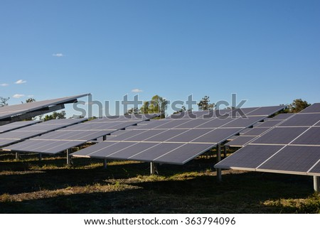 Photovoltaic solar energy panels and sunlight with blue sky