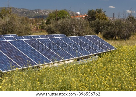 Photovoltaic solar panel inverter on the field close-up. horizontal