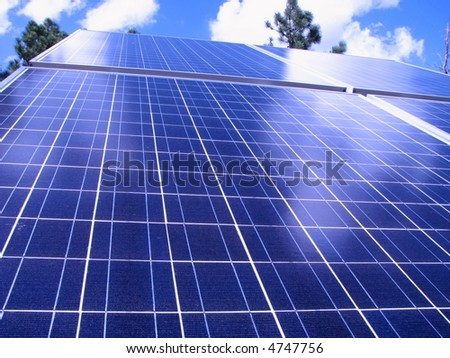photovoltaic solar panels at an angle with sky background - stock photo