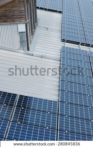 photovoltaic solar panels atop galvalume roof and dormer window of ecology center in milwaukee wisconsin - stock photo