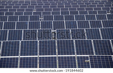 Photovoltaic system in a meadow - stock photo