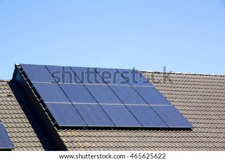 Photovoltaics on the roof of a residential building with copyspace