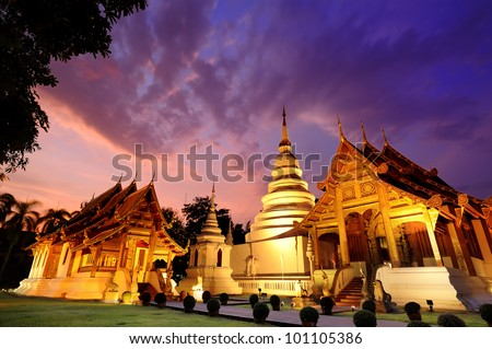 Phra Singh temple twilight time Viharn Lai Kam Wat Phra Singh is located in the western part of the old city center of Chiang Mai. - stock photo