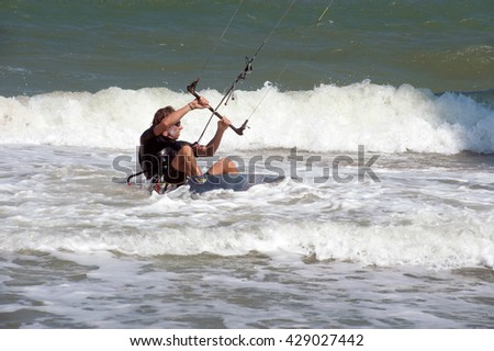 PHRACHUAP KHIRI KHUN,THAILAND-DECEMBER 20,2013 : Unidentified Kite surfer in action at Phranburi sea near Phranburi District. Preparation starting from the beach in Phrachuap Khiri Khun ,Thailand.  - stock photo