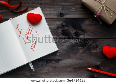 Phrase about love written in notebook. Valentines day concept