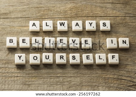 phrase always believe in yourself, over wooden background - stock photo