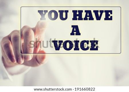 Phrase You have a voice on a virtual interface in a navigation bar with a businessman touching it with his finger from behind. - stock photo