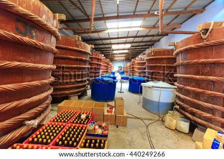 Phu Quoc island, Kien Giang province, Vietnam - May 02, 2016 : at factory fish sauce production facilities on Phu Quoc island by traditional fermented method of anchovies fermented brewed in large