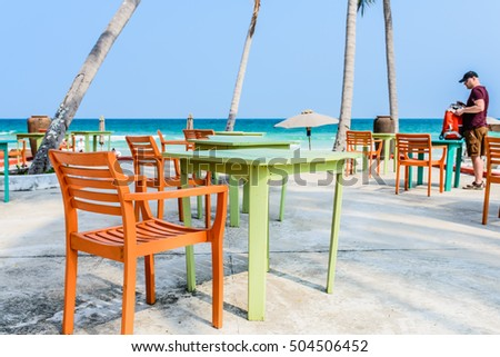 Phu Quoc Island, Kien Giang, Vietnam 11 March 2016: wooden furniture stand out side of a home stay in SAO Beach in Phu Quoc Island, near a man foreign tourist