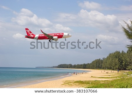 PHUKET - February 26, 2016 : Low flying airplanes landing near Nai Yang Beach on the island of Phuket in the Andaman sea on February 26, 2016