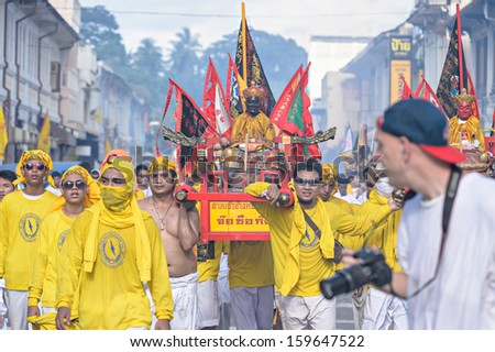 PHUKET - OCTOBER 10: an unidentified people who have faith of a Chinese Taoist shrine carry a palanquin housing a Chinese God idol in a street October 10, 2013 in Phuket Province, Thailand.