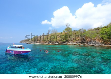 PHUKET, THAILAND - APR 14: Traveler snorkeling coral reef with clear blue tropical water holiday on April 14, 2010 in Phuket, Thailand. It is a popular snorkelling the famous round Racha Yai Island - stock photo