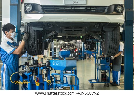 PHUKET, THAILAND - APRIL 22 : Car technician repairing car in workshop service station in Phuket on April 22, 2016. The official dealer of Toyota, who is the top market share for commercial car.