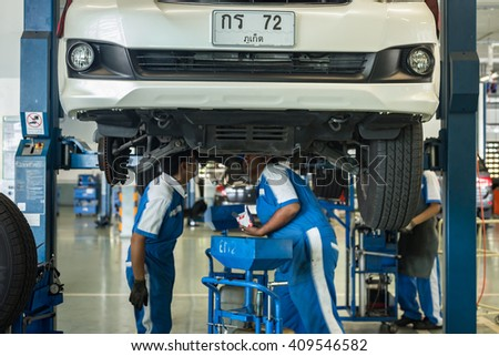 PHUKET, THAILAND - APRIL 22 : Car technician repairing car in workshop service station in Phuket on April 22, 2016. The official dealer of Toyota, who is the top market share for commercial car. - stock photo