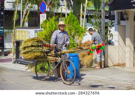 PHUKET, THAILAND - CIRCA MAR 2015: Sellers of brooms in a Thai village. Businesses small , which employed many Thai people, is thriving in Thailand - stock photo