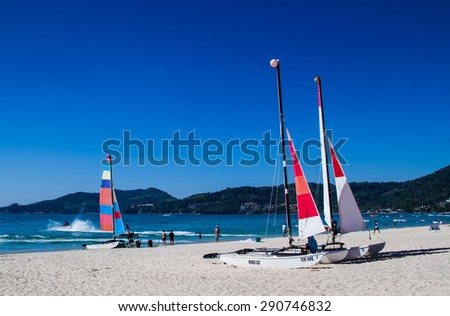 PHUKET,THAILAND-FEBRUARY 25 : Sailboat for rent at Patong beach in Phuket,Thailand on February 25,2015.Patong beach is the most popular beach in Phuket. - stock photo