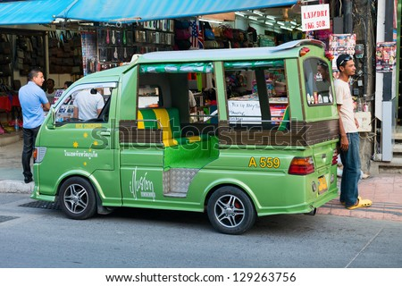 PHUKET, THAILAND - JAN 28: Tuk tuk taxi and driver on the street wait for clients on Jan 28, 2013 in Patong, Phuket, Thailand. Tuk-tuk is common taxi type in Phuket.
