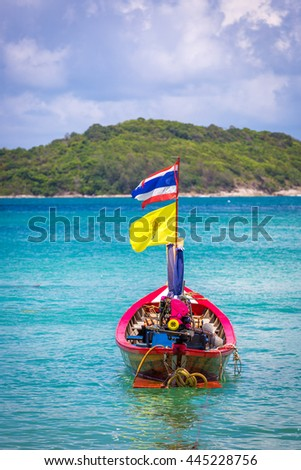 Phuket, Thailand - June 6th 2016 - Traditional boat in a amazing beach in Phuket in Thailand, Asia
