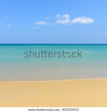 PHUKET, THAILAND - MARCH 25 , 2015: At leisure, Couple of people on beautiful beach spend their time at Karon beach, on March 25, 2015 in Phuket, Thailand