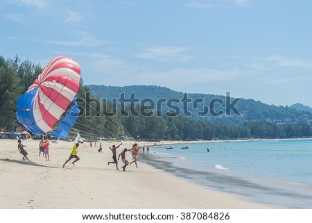 PHUKET, THAILAND - 07 March 2016 : 07 March 2016 Parasailing extreme sports on beach in blue sky background