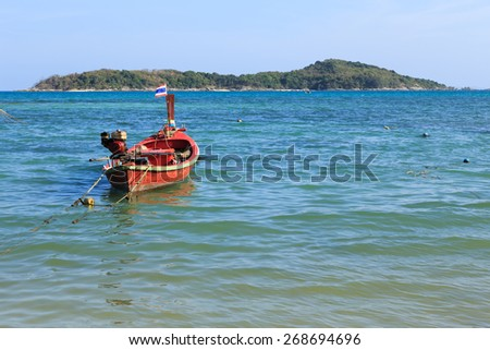 Phuket, Thailand - 30 March, 2015: Unidentified Fishermen are preparing their ship and children are enjoying on the beach at Rawai beach, Phuket province Thailand.