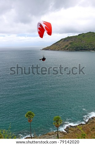 "PHUKET, THAILAND - MAY 21: Paragliding Competition, Annual event Canon photo contest "" Phuket Fun Fly "" on May 21, 2010 in Nai-harn beach, Phuket, Thailand."