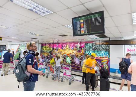 PHUKET, THAILAND - 29 MAY 2016: Tourists check air flight form display at Phuket international airport departures area at Phuket international airport. - stock photo