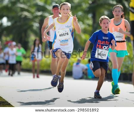 PHUKET, THAILAND - MAY 07: Unidentified children participants compete at  the Laguna Phuket  International marathon at Laguna on May 07, 2015 in Phuket, Thailand. - stock photo